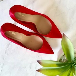 Also red satin pumps